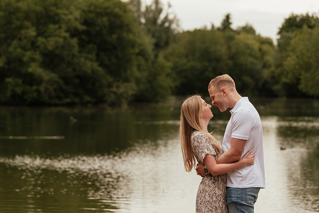 Couple embrace by the lake Stanborough Lake Couples Engagement Photo Shoot