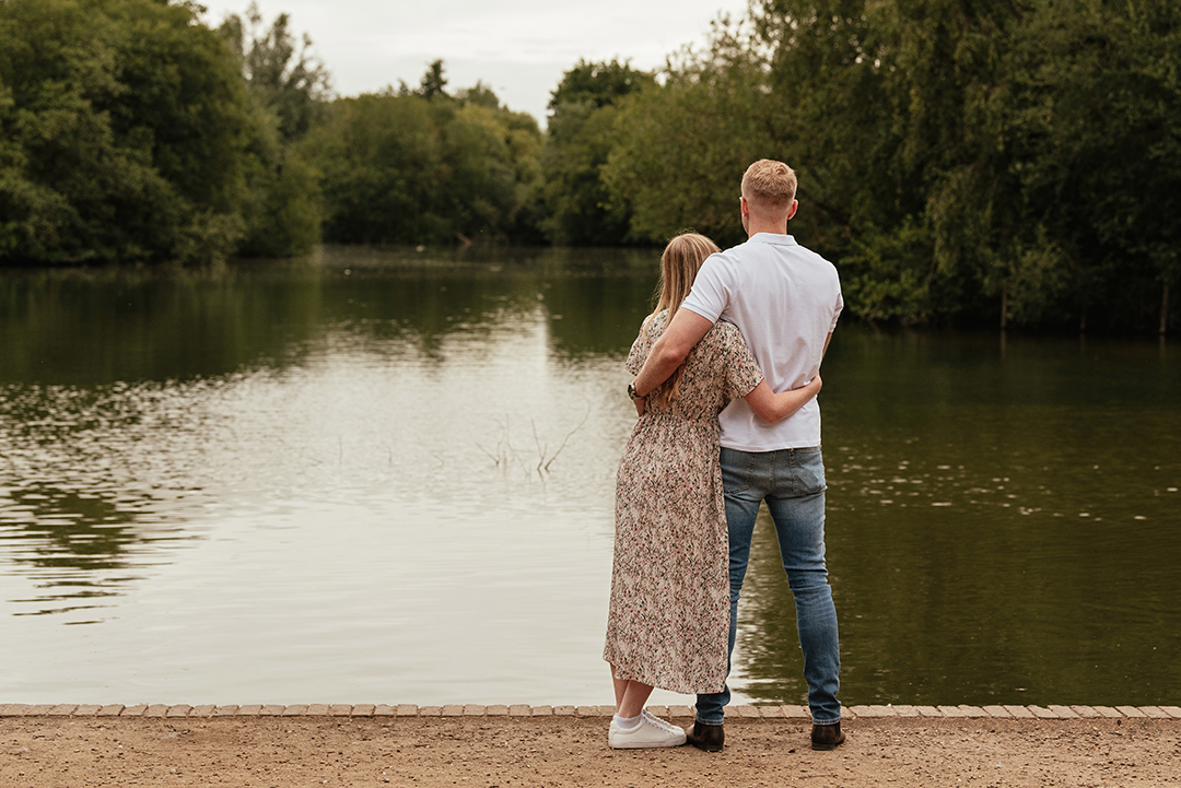 Couple look out at the lake Stanborough Lake Couples Engagement Photos