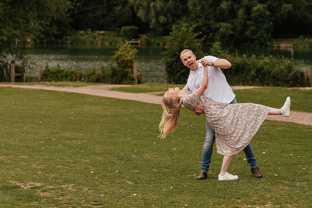 Practicing their first dance in front of the lake at Stanborough Lake Pre Wedding Photoshoot Ideas