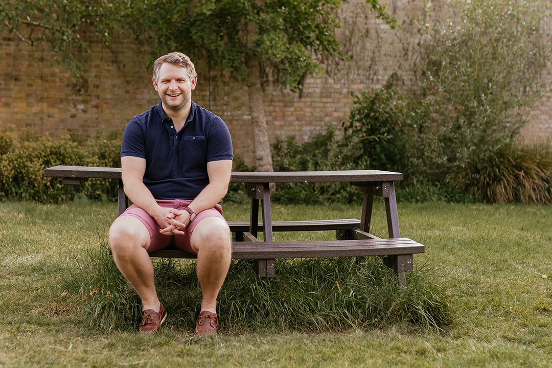 Portrait of ITU Physiotherapist, Ben Seated on Bench