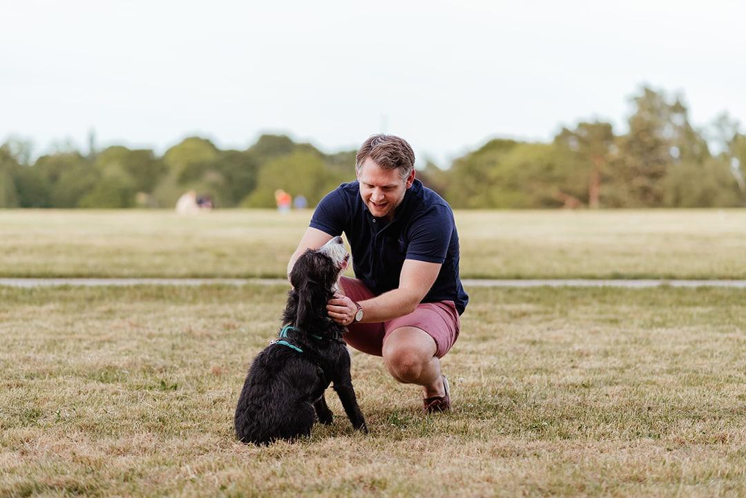 ITU Physiotherapist, Ben Kneels with his Dog