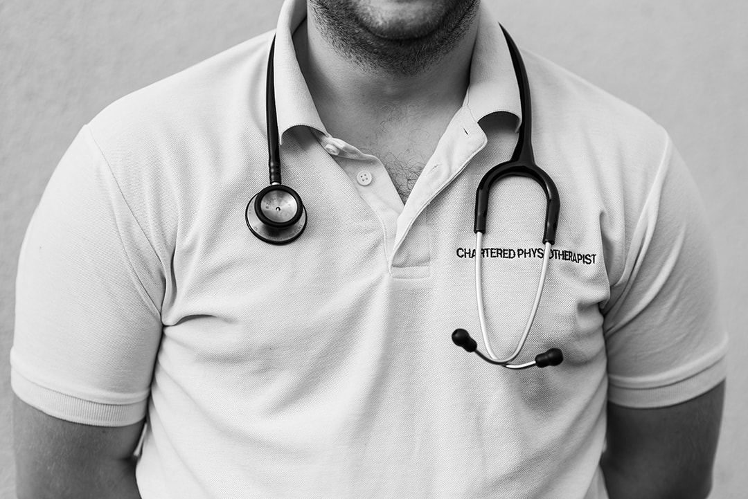 Black and White Close Up ITU Physiotherapist, Ben in Uniform with Stethoscope