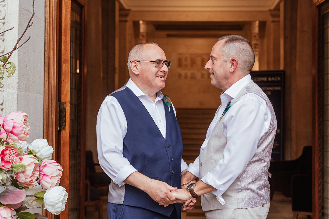Two Grooms Hold Hands Old Marylebone Town Hall Wedding