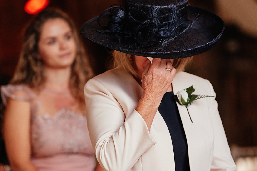 Family member wiping tears during Colville Hall Wedding Ceremony
