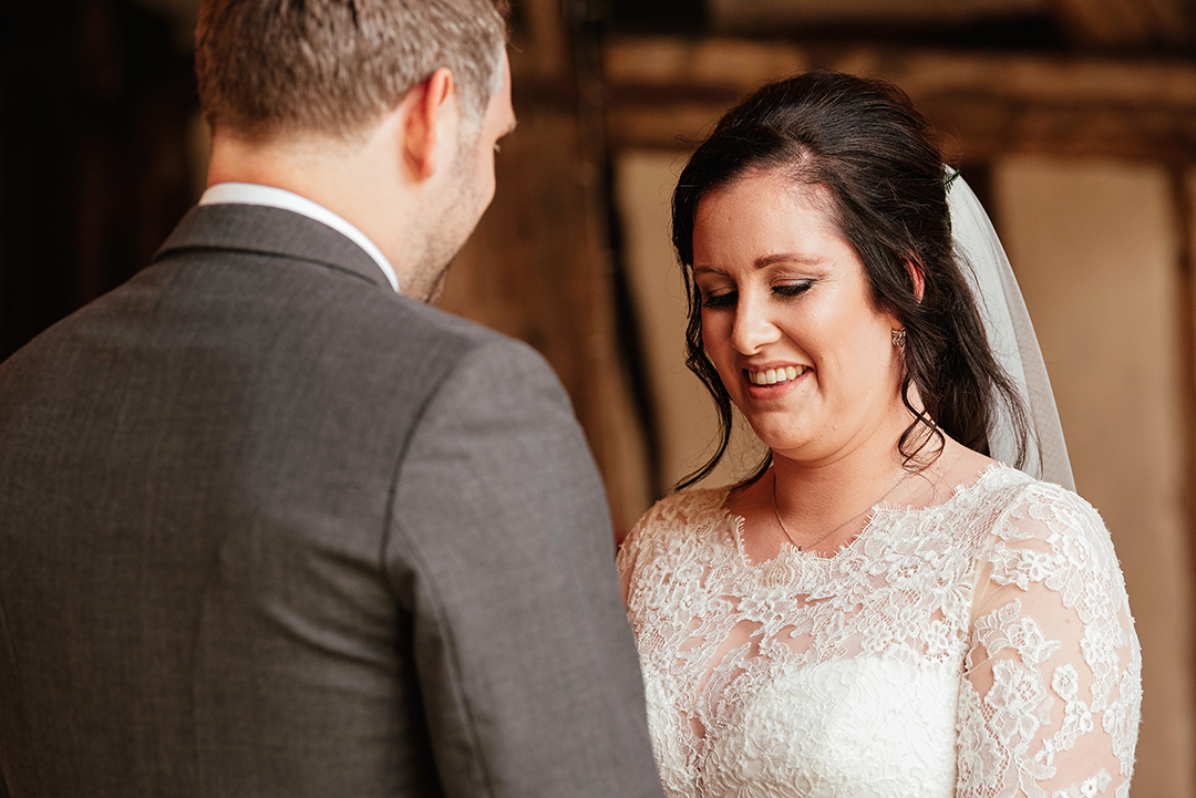 Bride looks down smiling in Colville Hall Wedding Ceremony