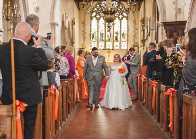 Couple walking back down the aisle after St Nicholas at Wade church ceremony