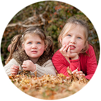Laying in Autumn Leaves Children Photography at Cheshunt Broxbourne
